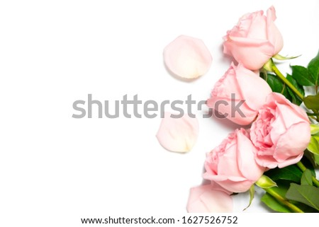 Decorative flat lay composition with light pink rose flowers compositions on white background with space for text.Sweet and romantic concept.Top view background. #1627526752