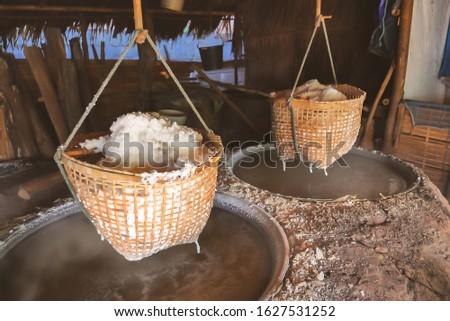 Boiling salt water, folk wisdom making sinthao salt or rock salt at Bo Kluea rock salt pond at Bo Kluea District Nan province, Thailand. #1627531252