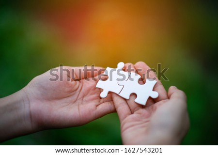 Hands and puzzles, important pieces of teamwork Teamwork concept #1627543201