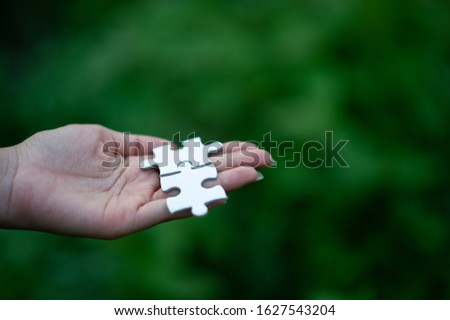 Hands and puzzles, important pieces of teamwork Teamwork concept #1627543204
