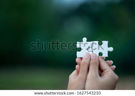 Hands and puzzles, important pieces of teamwork Teamwork concept #1627543210