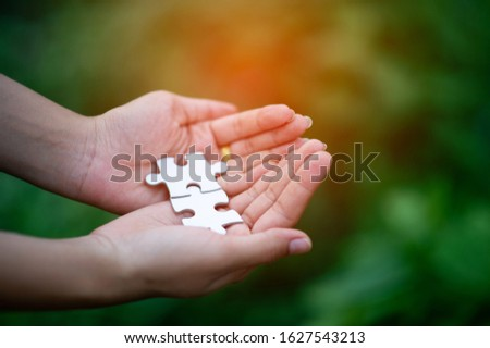 Hands and puzzles, important pieces of teamwork Teamwork concept #1627543213