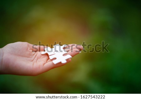 Hands and puzzles, important pieces of teamwork Teamwork concept #1627543222