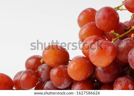 Red grape isolated on white background. Grapes can be eaten fresh as table grapes or they can be used for making wine, jam, grape juice, jelly, grape seed extract, raisins, vinegar, and grape seed oil #1627586626