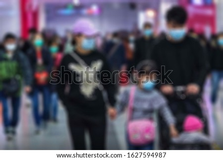 "Blurry view of small family using health masks to prevent the spread of the corona virus.viruses that include the common cold, and viruses such as SARS and MERS. This new virus was  named ""COVID19"" Royalty-Free Stock Photo #1627594987"