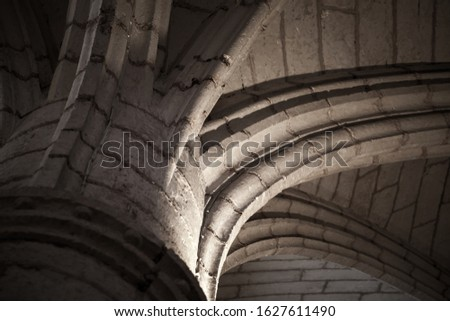 Connection of a column and arched vault, abstract architectural background photo. Classic Gothic architecture example #1627611490