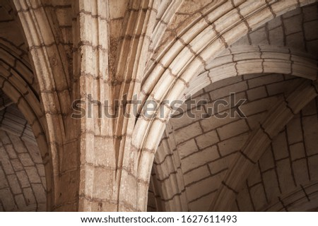 Classic Gothic column and arched vault, abstract architectural background photo #1627611493