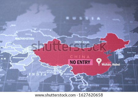 Coronavirus at Wuhan China. The red map of china on world map with NO ENTRY label. Coronavirus background concept. Royalty-Free Stock Photo #1627620658