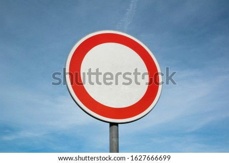 No entry - prohibitiory trafic sign is prohibiting and forbidding to enter and trespass. Blue sky with clouds as copy space.