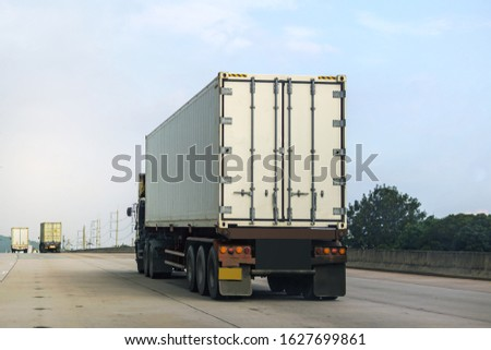White Truck driving on highway road with  container, transportation concept.,import,export logistic industrial Transporting Land transport on the asphalt expressway #1627699861