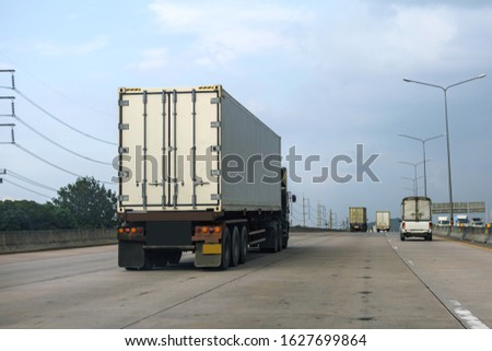 White Truck driving on highway road with  container, transportation concept.,import,export logistic industrial Transporting Land transport on the asphalt expressway #1627699864