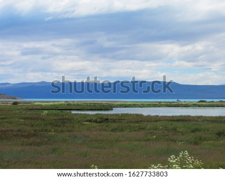Patagonian landscape encompassing Nimez Lagoon, Argentino Lake and the Andes mountaing range in a sunny day. #1627733803