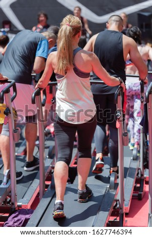 Girl Exercising Outdoor on Treadmill in an Outdoor Gym. #1627746394