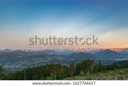 Sunset illuminates the mountain peaks in orange.Alpine landscape, Mont Blanc mountain peak, Mont Blanc massif.View from the top of Le Signal des Voirons,Haute-Savoie in France. #1627766617
