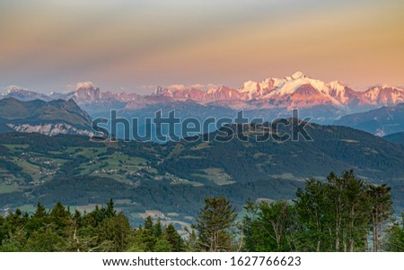 Sunset illuminates the mountain peaks in orange.Alpine landscape, Mont Blanc mountain peak, Mont Blanc massif.View from the top of Le Signal des Voirons,Haute-Savoie in France. #1627766623