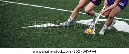 women's lacrosse player on the field