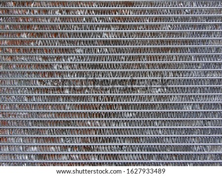 Close up on a piece of agricultural tractor, it is an agricultural radiator. #1627933489