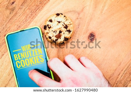 cookies with a tablet to illustrate cookie banners for websites #1627990480