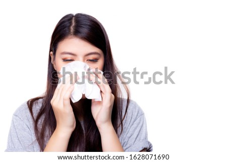 Novel coronavirus 2019 concept. Asian woman has a stuffed nose or runny nose and has a fever. Beautiful asian girl get coronavirus when she go to china. Novel coronavirus 2019 is epidemic. copy space Royalty-Free Stock Photo #1628071690