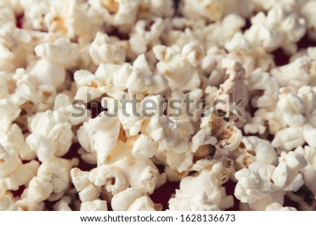 Scattered heap of delicious popcorn. #1628136673