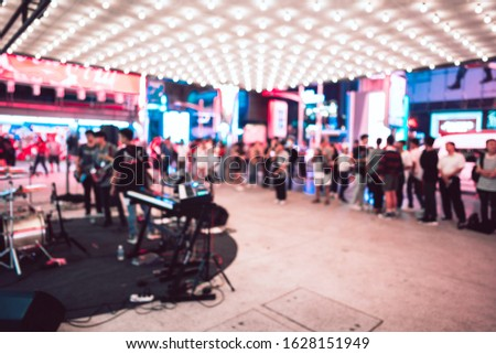 Blur background defocused bokeh with people live mini concert event. Front of vintage theatre. #1628151949