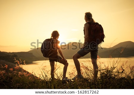 Mother and daughter  watching the sunset on the lake #162817262