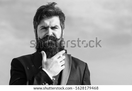 Facial hair beard and mustache care. Beard fashion trend. Invest in stylish appearance. Grow thick beard fast. Man bearded hipster wear formal suit blue sky background. Vintage style long beard. #1628179468