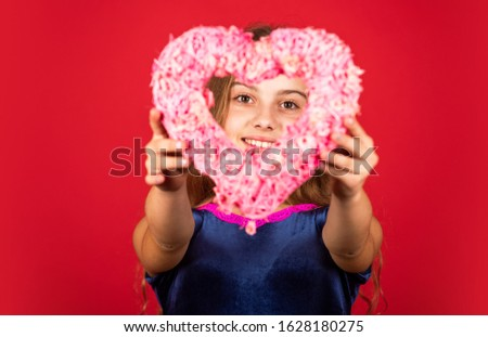 Heart shaped decor valentines day. Feeling loved. Lovely baby. Adorable girl having fun. Romantic mood. Happy child hold heart red background. Holiday of love and care. Little girl with pink heart. #1628180275