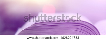Book stack in the library and blurred bookshelf background for education. Education background. Back to school  concept. Open book design for decorate wallpaper and learning classroom. #1628224783