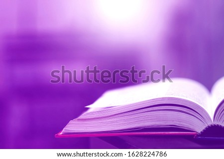 Book stack in the library and blurred bookshelf background for education. Education background. Back to school  concept. Open book design for decorate wallpaper and learning classroom. #1628224786