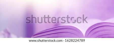 Book stack in the library and blurred bookshelf background for education. Education background. Back to school  concept. Open book design for decorate wallpaper and learning classroom. #1628224789