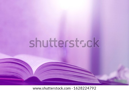 Book stack in the library and blurred bookshelf background for education. Education background. Back to school  concept. Open book design for decorate wallpaper and learning classroom. #1628224792