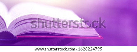 Book stack in the library and blurred bookshelf background for education. Education background. Back to school  concept. Open book design for decorate wallpaper and learning classroom. #1628224795