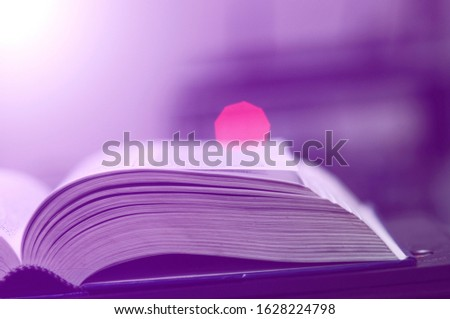 Book stack in the library and blurred bookshelf background for education. Education background. Back to school  concept. Open book design for decorate wallpaper and learning classroom. #1628224798
