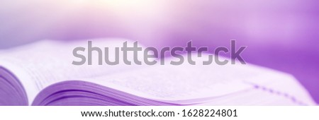 Book stack in the library and blurred bookshelf background for education. Education background. Back to school  concept. Open book design for decorate wallpaper and learning classroom. #1628224801