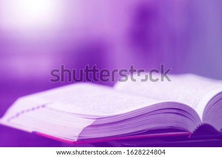 Book stack in the library and blurred bookshelf background for education. Education background. Back to school  concept. Open book design for decorate wallpaper and learning classroom. #1628224804