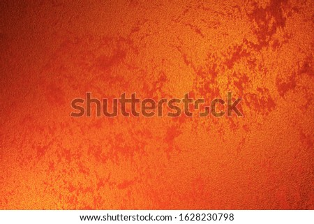 Vintage orange-brown for design background. Bright backdrop. Art plaster. Illuminated surface. Abstract image. Bitmap image.e. Bitmap image. #1628230798