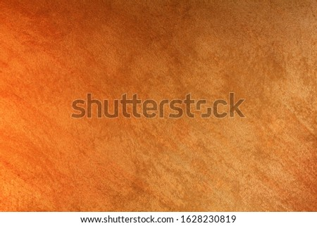 Vintage orange-brown for design background. Bright backdrop. Art plaster. Illuminated surface. Abstract image. Bitmap image.e. Bitmap image. #1628230819