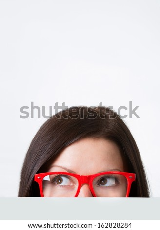 Woman in red-framed eyeglasses looking away, close-up shot #162828284