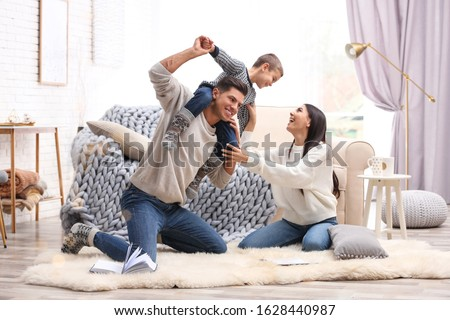 Happy family with little son having fun at home. Winter vacation #1628440987