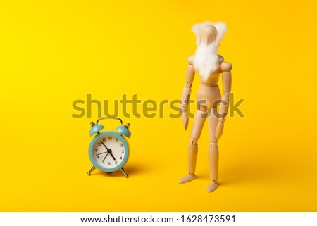 Old age and retirement (pension) concept, figure of man with beard and clock. #1628473591