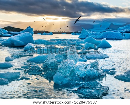 Amazing sunset over the famous glacier lagoon Jokulsarlon, view of icebergs floating. Location: Jokulsarlon glacier lagoon, Iceland. Artistic picture. Beauty world. Travel concept #1628496337