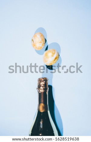 Easter party theme image, conceptual image, golden egg. champagne, , top view, retro tonality