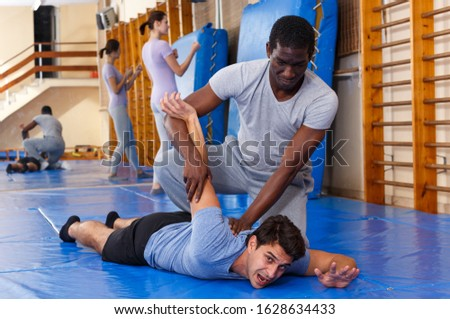 Males training attack movements in pair at self protection workout #1628634433