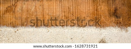 background texture of weathered barn wood with grain and white paint peeling off, panoramic banner #1628731921