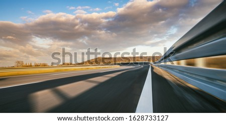 Race Car / motorcycle racetrack after rain on a sunny day. Fast motion blur effect. Ready to race #1628733127