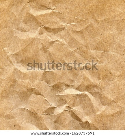 Textured obsolete crumpled packaging brown paper background #1628737591