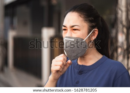 women wearing hygienic mask to prevent the virus PM2.5 and Coronavirus. People in masks The outbreak of Novel Corona virus (2019-nCoV) in Wuhan China. air pollution, Environmental awareness concept #1628781205