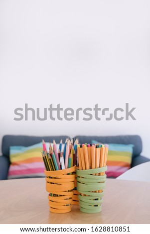 Isolated set of pencils on a colorful holder. Drawing at school and develop creativity. Arts and crafts concept. Artistic education. Back to school for children. Designer and illustrator lifestyle. #1628810851