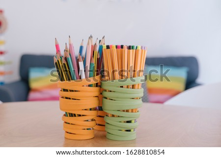 Isolated set of pencils on a colorful holder. Drawing at school and develop creativity. Arts and crafts concept. Artistic education. Back to school for children. Designer and illustrator lifestyle. #1628810854